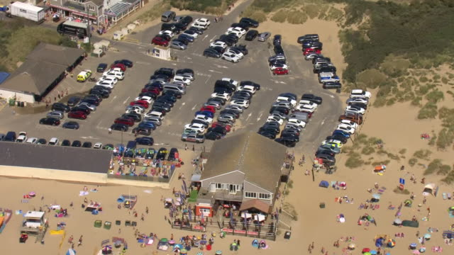 aerial shots of people sunbathing and in the sea on a sunny day on camber sands beach on 7 august 2020 in camber, united kingdom - summer stock videos & royalty-free footage