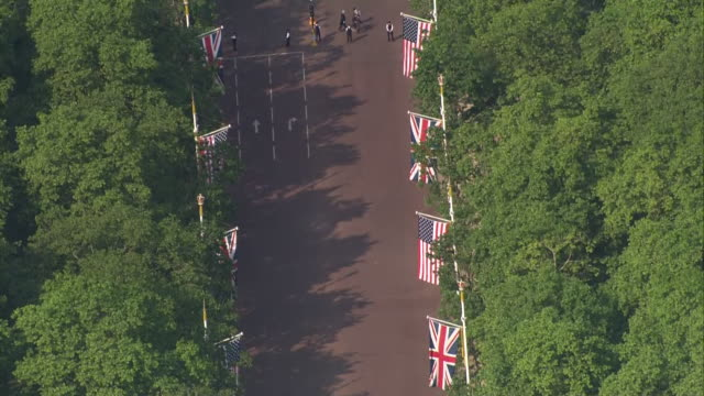 aerial shots of police officers on the mall leading to buckingham palace during the first day of us president donald trump's state visit to the uk on... - state visit stock videos & royalty-free footage