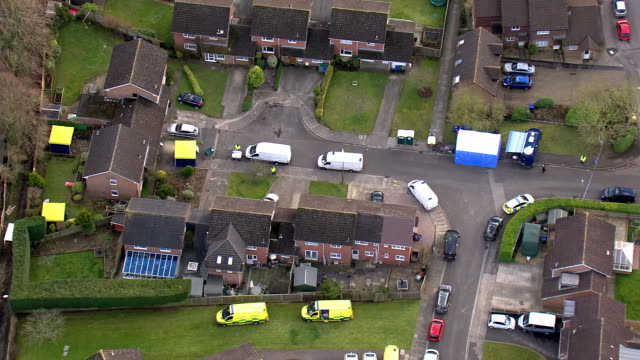aerial shots of police officers, tents and emergency services vehicles outside the former russian spy sergei skripal's home on 7 march, 2018 in... - toxic substance stock videos & royalty-free footage