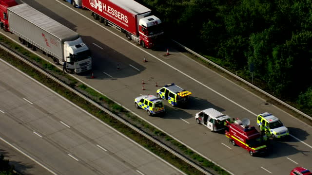aerial shots of police vehicles fire engines and parked lorries on a motorway near dover during disruption caused by ferry workers at calais going on... - calais stock videos and b-roll footage