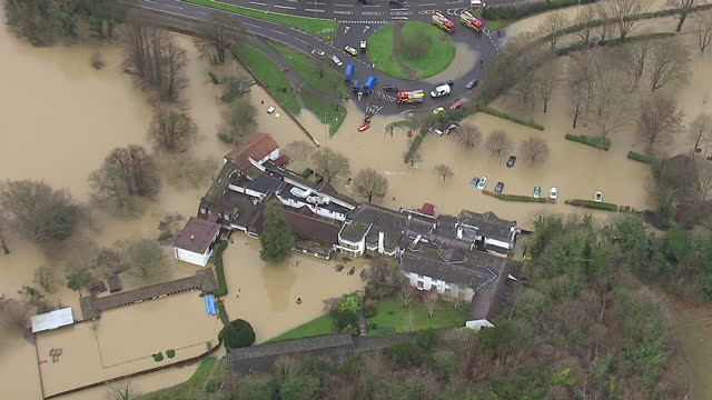 aerial shots of rescue workers and stranded cars outside the flooded burford bridge hotel in mickleham surrey after teh river mole burst its banks... - 2013 stock videos & royalty-free footage