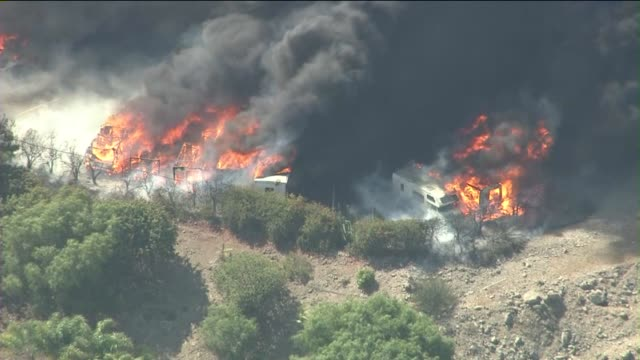 ktla aerial shots of rvs burning in wildfire on may 03 2013 in camarillo california - camarillo stock videos & royalty-free footage