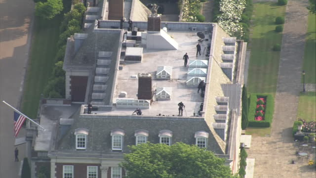 aerial shots of security and police on the roof of the winfield house the residence of the us ambassador on the first day of us president donald... - australian politics stock videos & royalty-free footage