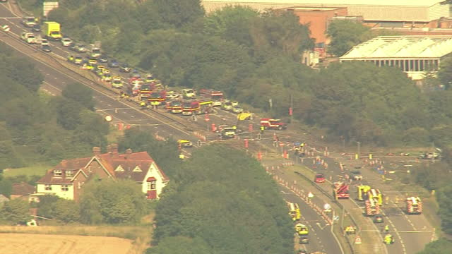 aerial shots of shoreham airshow plane crash site on the a27 road with emergency vehicles at scene on august 22 2015 in shorehambysea england - ショーハム・バイ・シー点の映像素材/bロール