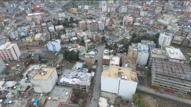 aerial shots of sirnak's cizre district where barricades and ditches dug by the terrorists to keep police and soldiers out of certain neighborhoods... - silopi stock videos and b-roll footage