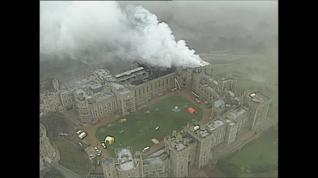 aerial shots of smoke coming from the fire at windsor castle on november 21 1992 in windsor england - windsor england stock videos and b-roll footage
