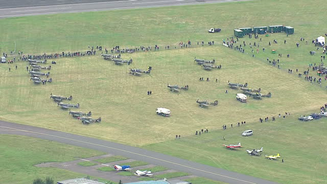"aerial shots of spitfires & hurricanes on the ground for a fly over south-east england to mark 75 years since the battle of britain's ""hardest day"",... - biggin hill stock videos & royalty-free footage"
