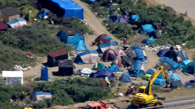 aerial shots of tents and makeshift shelters at illegal migrant camps near the port of calais and lorries parked at the port of calais during a... - calais stock videos and b-roll footage