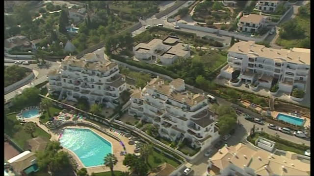 aerial shots of the apartments where madeleine mccann went missing on may 5, 2007 in praia da luz, portugal. - madeleine mccann stock videos & royalty-free footage