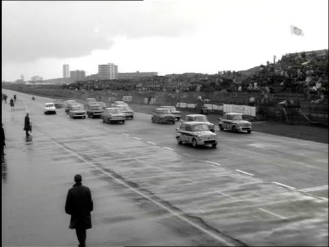 stockvideo's en b-roll-footage met aerial shots of the crowded beach at zandvoort and racing cars on the circuit in zandvoort the bad weather later in the day leaves the beach deserted... - noord holland
