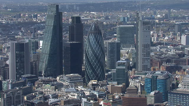 aerial shots of the gherkin building 30 st mary axe and surrounding skyscrapers including the walkie talkie building and the shard on april 11 2014... - swiss re stock videos & royalty-free footage
