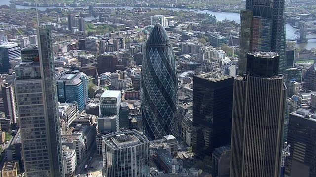 aerial shots of the gherkin building 30 st mary axe and surrounding skyscrapers on april 11 2014 in london england - swiss re stock videos & royalty-free footage