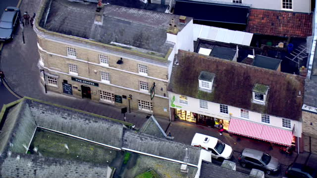 aerial shots of the grapes pub pans over to hughes electrical store locations where missing corrie mckeague was known to visit before his... - bury st edmunds stock videos & royalty-free footage