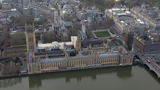 aerial shots of the houses of parliament and skyline of the city behind it on 21st february 2021 in london, united kingdon. - skyline stock videos & royalty-free footage