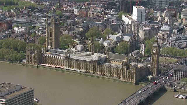 Aerial shots of the Houses of Parliament including close up shots of the Big Ben clock tower and shots of the Union Jack flag flying from the...