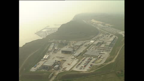 aerial shots of the iconic white cliffs of dover and the area of the channel tunnel construction site on february 10, 1989 in dover, england. - eurotunnel folkestone stock-videos und b-roll-filmmaterial