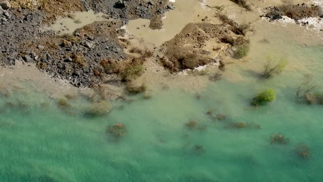aerial shots of the jurassic coast in dorset following a huge cliff fall, the biggest rockfall in 60 years seen on the jurassic coast, and paddle... - cliff stock videos & royalty-free footage