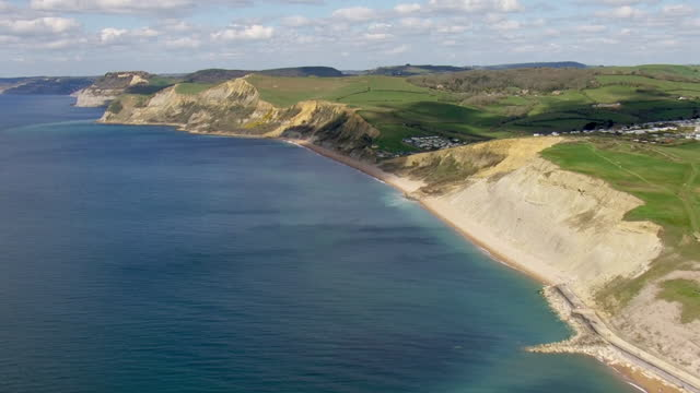 aerial shots of the jurassic coast in dorset following a huge cliff fall, the biggest rockfall in 60 years seen on the jurassic coast, on 15th april... - cliff stock videos & royalty-free footage