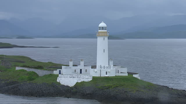 aerial shots of the lighthouse on eilean musdile off the isle of lismore inner hebrides scotland - hebrides stock videos & royalty-free footage