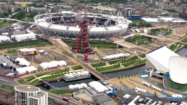 aerial shots of the olympic stadium the day after the opening ceremony - cauldron burning. sky news olympics day 1 coverage at olympic stadiumj on... - day 1 stock videos & royalty-free footage