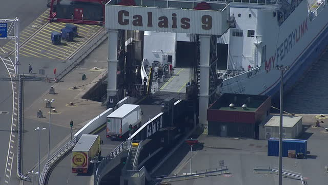 Aerial shots of the port of Calais with lorries boarding a cargo ferry at one of the terminals>> on August 05 2014 in Various Cities France
