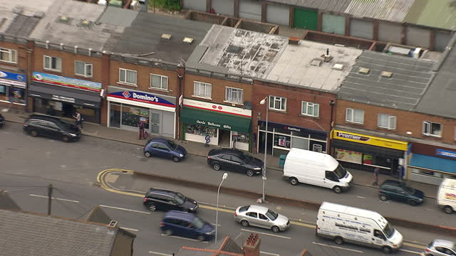 Aerial shots of the Post Office a Dominoes Pizza fast food take away shop and a Natwest bank branch along a shopping street on June 30 2014 in Rumney...