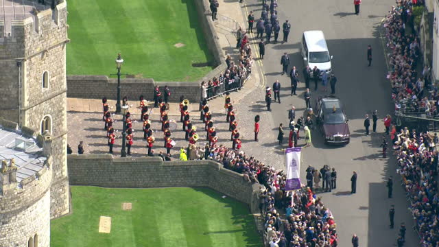 aerial shots of the queen arriving at windsor castle nd crowds lining the streets to welcome her on her 90th birthday on april 21 2016 in windsor... - windsor castle stock videos & royalty-free footage