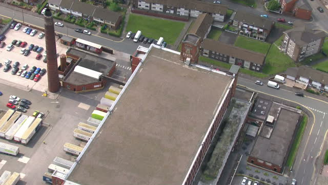 aerial shots of the raven mill building historically used for textile milling on may 19 2014 in oldham greater manchester england - mill stock videos & royalty-free footage
