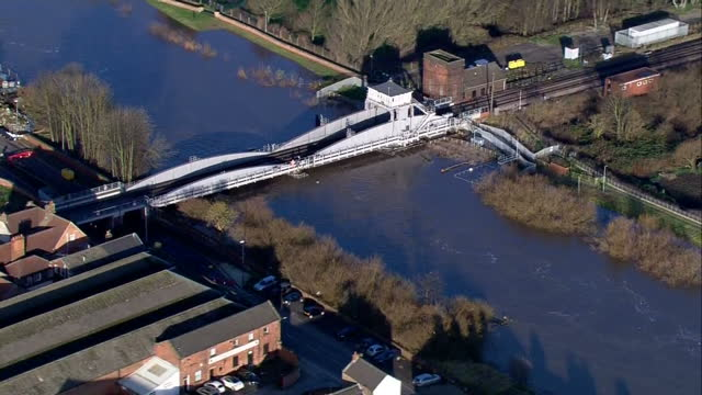 aerial shots of the river ouse running very high and fast through selby.>> on december 29, 2015 in selby, united kingdom. - river ouse stock videos & royalty-free footage