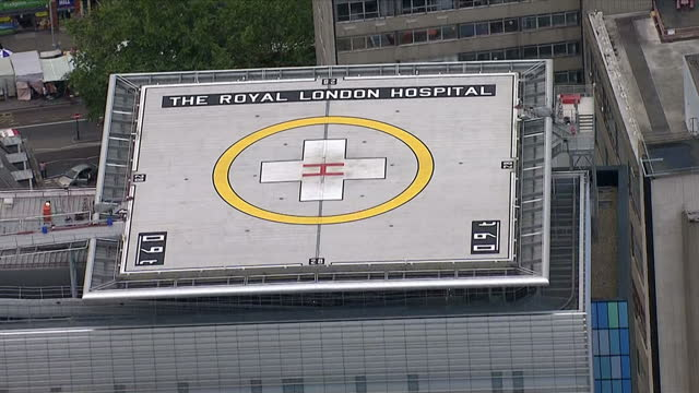 aerial shots of the royal london hospital showing the helipad with 'the royal london hospital' written on it>> on august 16 2014 in london united... - helipad stock videos & royalty-free footage
