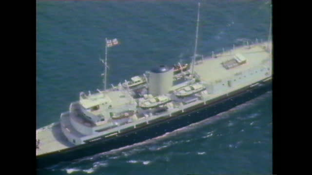 aerial shots of the royal yacht britannia sailing out from portsmouth in preparation for lady diana and prince charles' honeymoon. - sailing stock videos & royalty-free footage