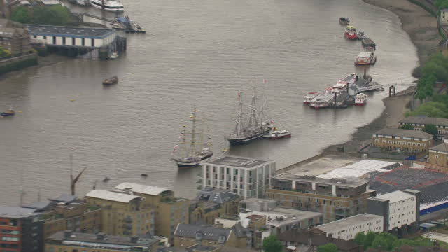 vídeos de stock, filmes e b-roll de aerial shots of the shard vessels anchored on the thames for the diamond jubilee weekend queen elizabeth ii diamond jubilee coverage on january 17... - ancorado