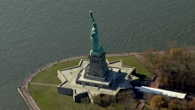 stockvideo's en b-roll-footage met aerial shots of the statue of liberty - statue of liberty new york city