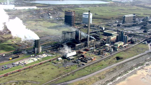 aerial shots of the steelworks at port talbot.>> on march 30, 2016 in port talbot, wales. - steel mill stock videos & royalty-free footage