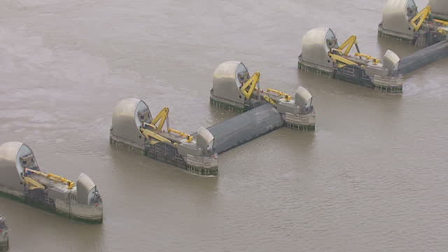 aerial shots of the thames barrier on the river thames with most of its flood gates in the closed position many homes and businesses affected by... - 2013 stock videos & royalty-free footage