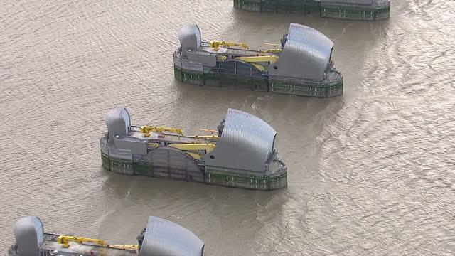 aerial shots of the thames flood barrier on the river thames with the rotating flood gates in the open position during low tide london thames flood... - 2013 stock videos & royalty-free footage