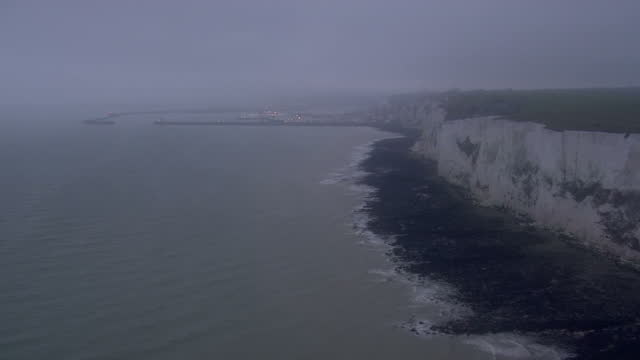 Aerial shots of the white cliffs of Dover and coastline fog and grey skies at dusk on March 29 2017 in Dover England