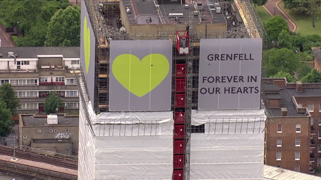 aerial shots of the wreckage of grenfell tower covered in white sheets including shots of large signs and banners at the top of grenfell tower... - heart shape stock videos & royalty-free footage