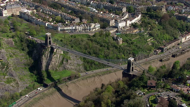 aerial shots of traffic driving over clifton suspension bridge on april 15, 2014 in bristol, england. - bristol england stock videos & royalty-free footage