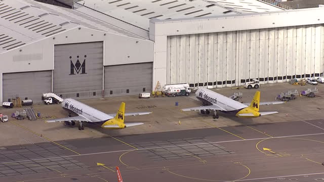 aerial shots of two monarch airlines planes parked at luton airport, following the announcement that the company has ceased trading and cancelled all... - luton airport stock videos & royalty-free footage