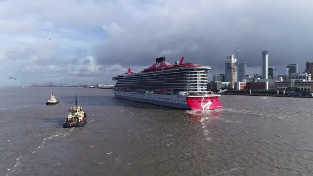 aerial shots of virgin voyages 'scarlet lady' cruise ship arrives at liverpool for star-studded extravaganzathe 'scarlet lady' cruise ship arrives... - cruise stock videos & royalty-free footage