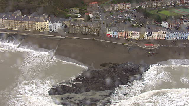aerial shots of waves hitting the beach on the promenade and seafront on january 5 2014 in aberystwyth wales - aberystwyth stock videos & royalty-free footage