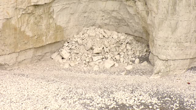 stockvideo's en b-roll-footage met aerial shots of white chalk cliffs along the south coast with signs of coastal erosion on 5 march 2021 in brighton, united kingdom - geërodeerd