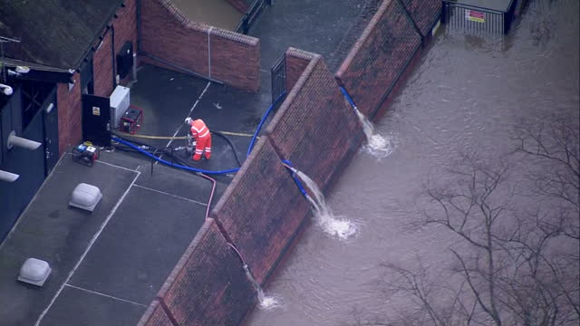Aerial shots of workmen at the Foss Barrier in York with pipes pumping water from the River Foss into the River Ouse>> on December 28 2015 in York...