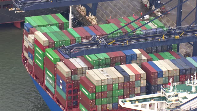 aerial shots over felixstowe port with large container ships docked on 9 december 2020 in london, united kingdom - moored stock videos & royalty-free footage