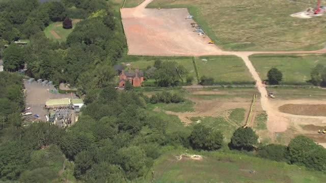 aerial shots over the proposed west london section of the hs2 rail link including a construction site and the farmhouse of ron and anne ryall... - demolished stock videos & royalty-free footage