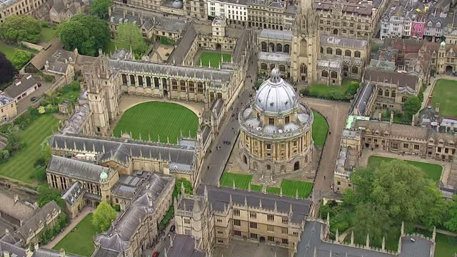 aerial shots oxford city with radcliffe camera on may 25, 2015 in oxford, england. - oxford england video stock e b–roll