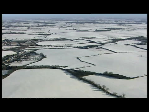 aerial shots patchwork countryside, fields covered in blanket of snow . - patchwork stock videos & royalty-free footage