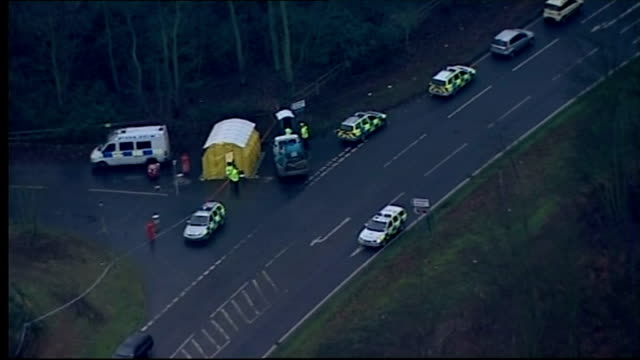 Aerial shots police tents by roadside and cordon tape strung through woods where bodies of Annette Nicholls and Paula Clennel were discovered on...