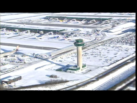 aerial shots snow covered stansted airport terminal buildings control tower stationary planes car park aerial shots ryanair plane being deiced - personal land vehicle stock videos & royalty-free footage